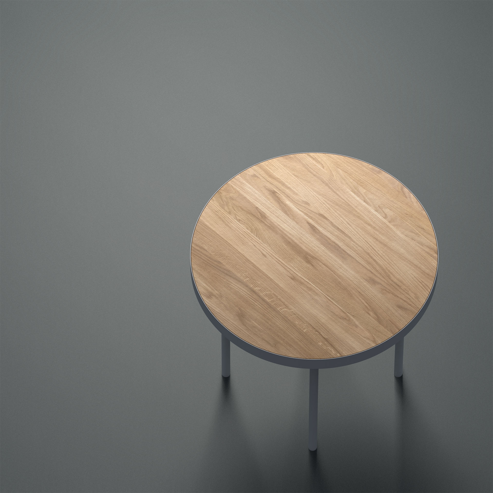 The unsettled side table from a high angle and dramatically lit, highlighting its wooden table top