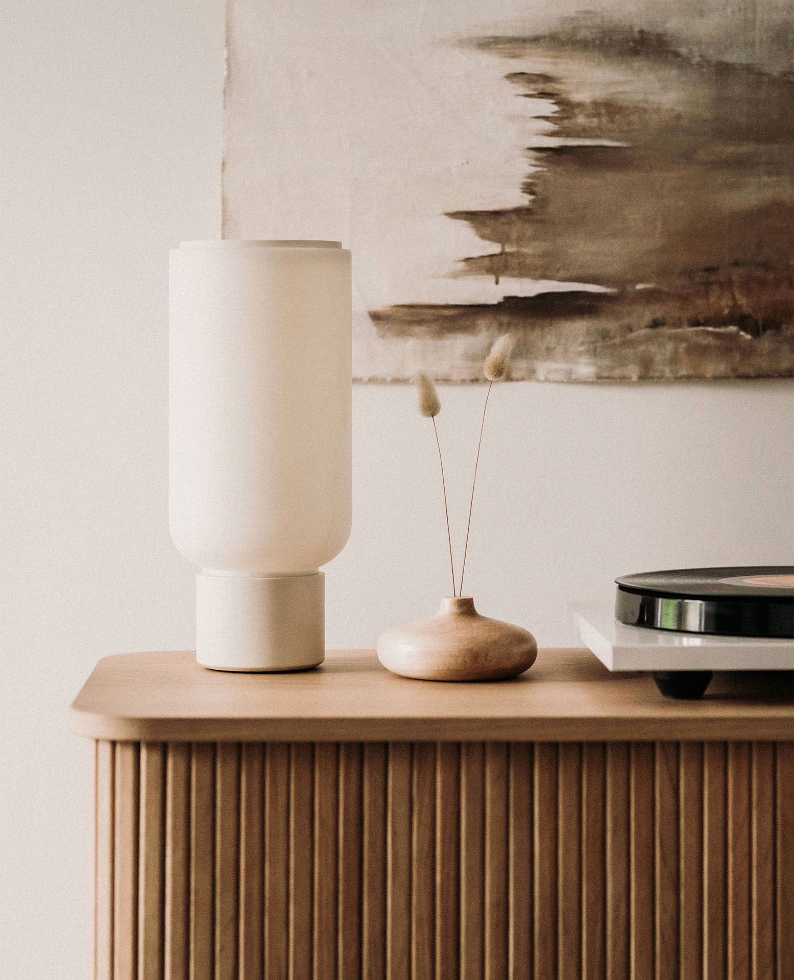 Arpeggio Table Light for Gantri, placed on a minimal sideboard