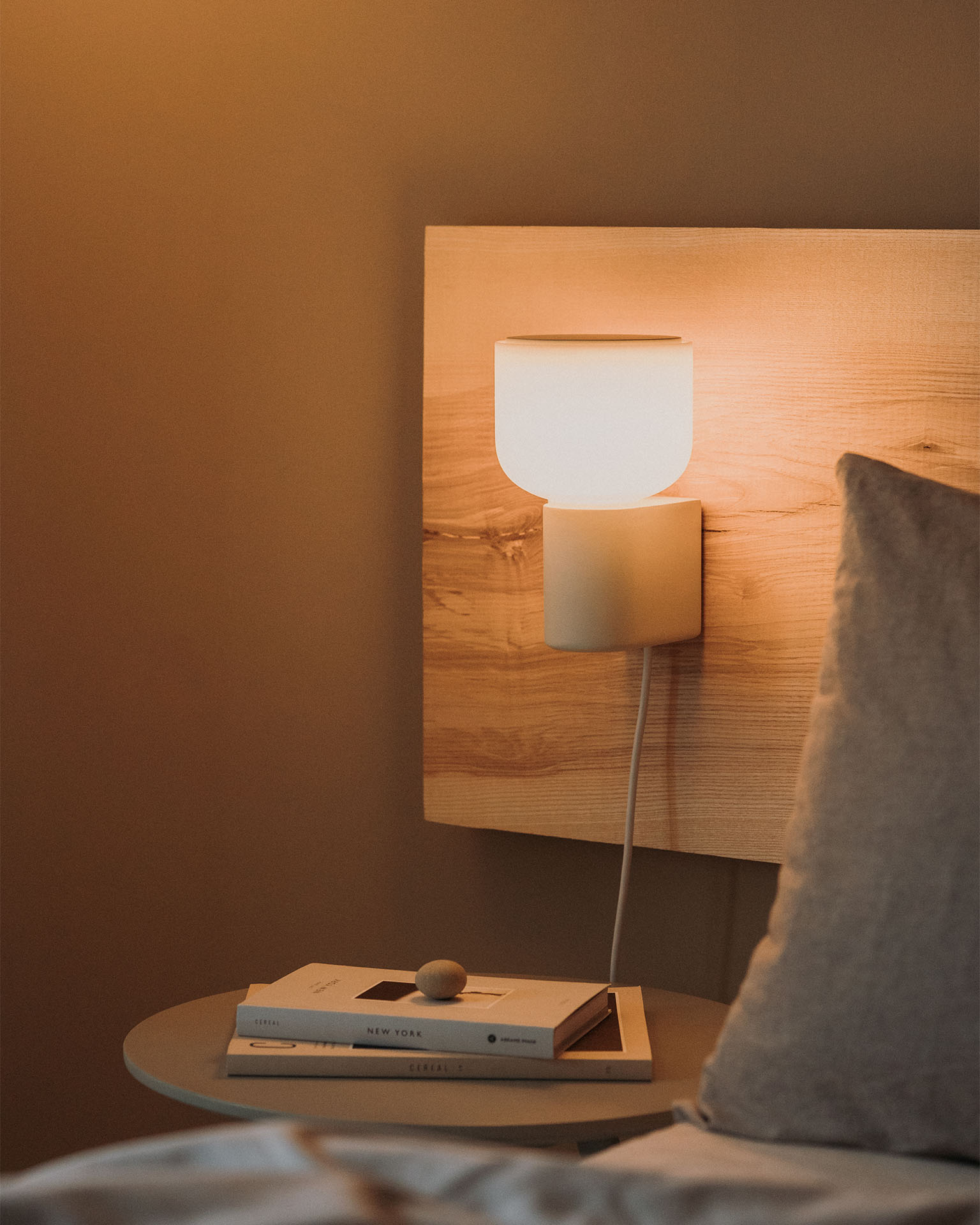 Arpeggio Wall Light for Gantri, mounted about a bedside table