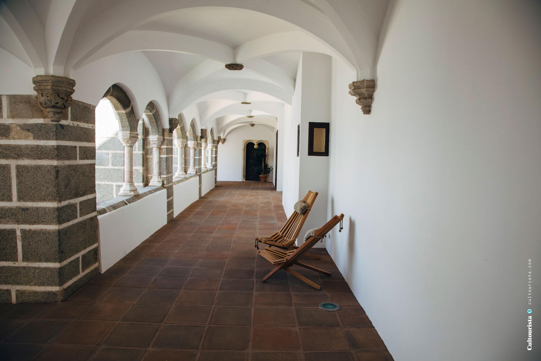 Corridor and chair at the Hotel Convento do Espinheiro in Evora Alentejo