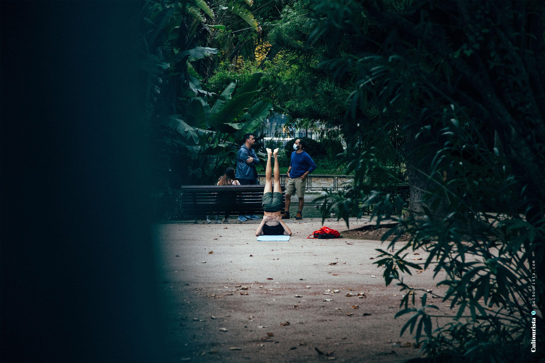 Person doing yoga at the Jardim da Estrela park in Lisbon Portugal