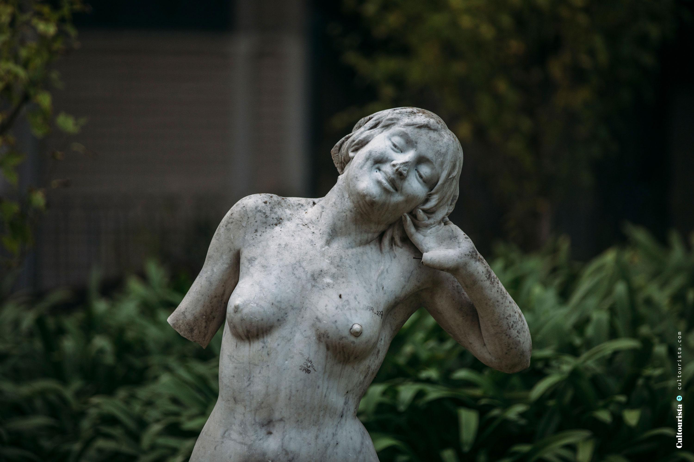 Smiling statue at the Jardim da Estrela park in Lisbon Portugal