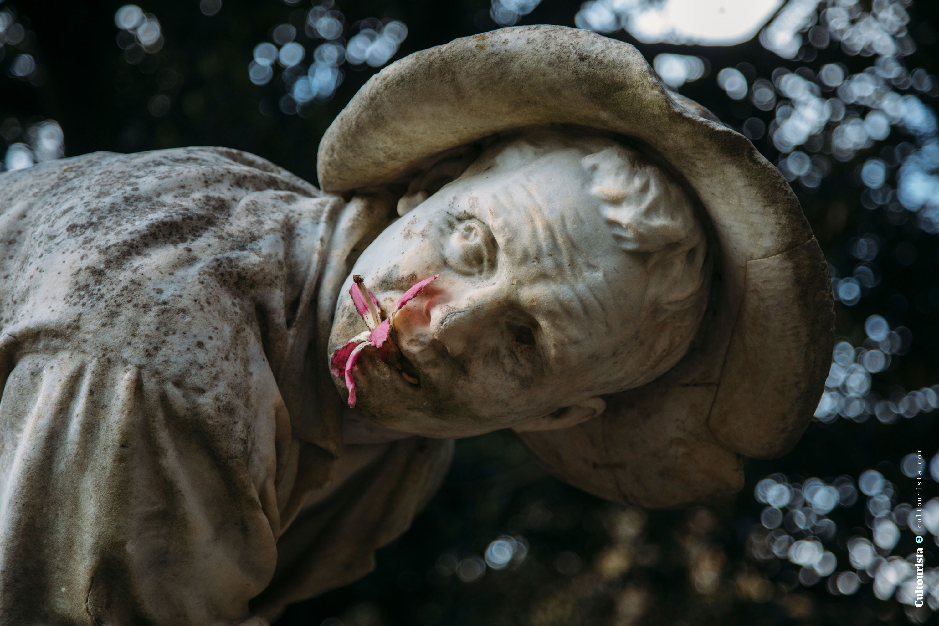 Sculpture with a flower in the mouth at the Jardim da Estrela park in Lisbon Portugal