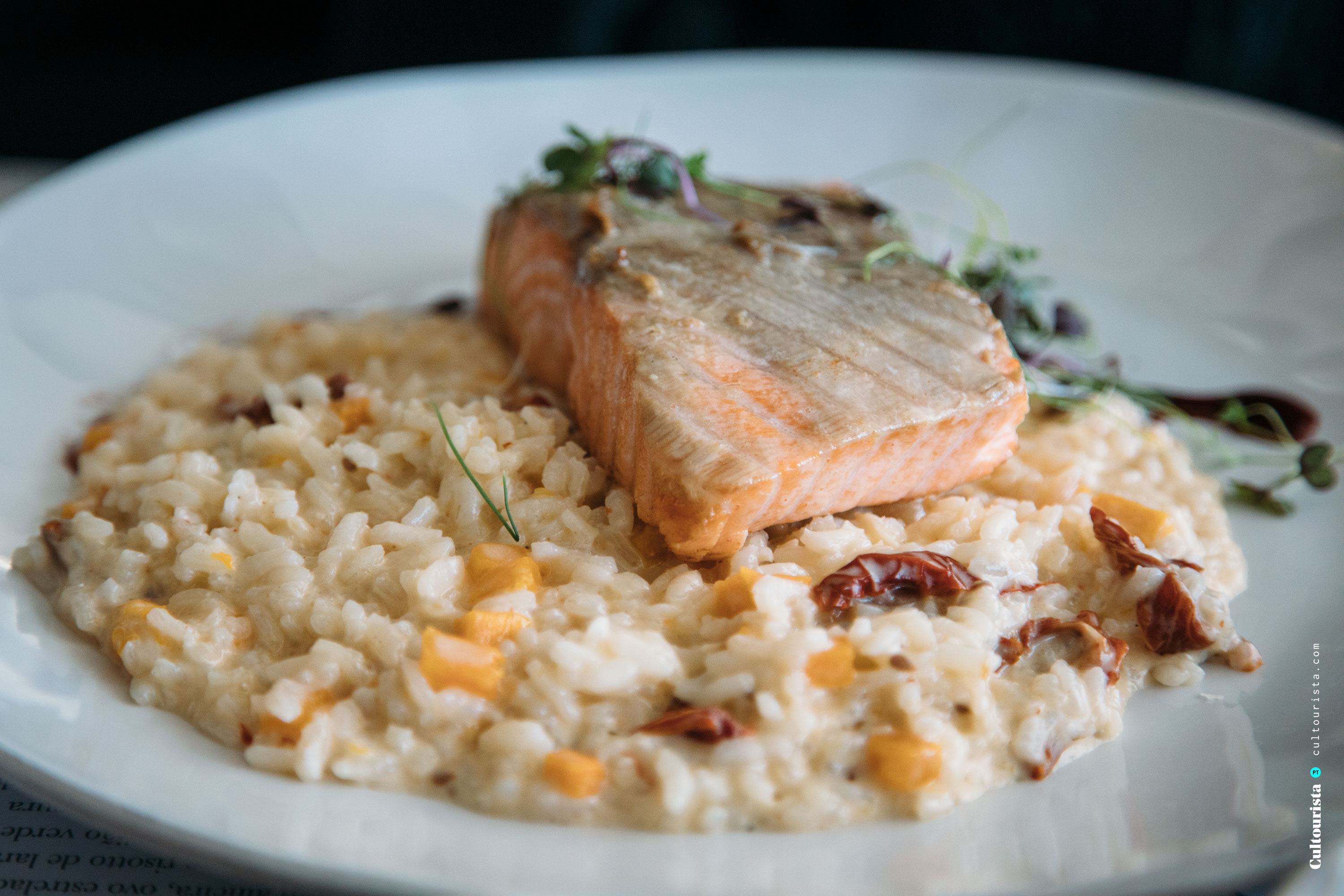 Salmon with risotto at the restaurant Darwin's Cafe in Belém Lisbon