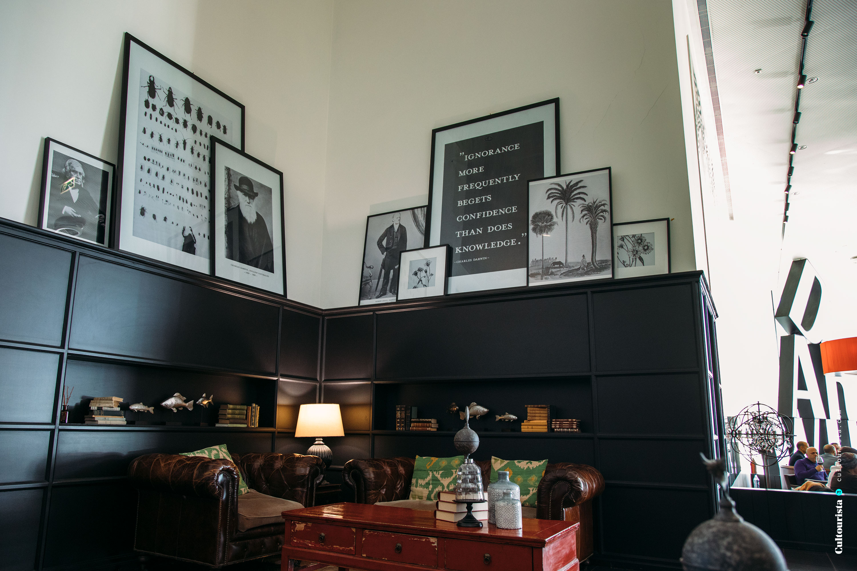Corner with posters and other details of interior design at the restaurant Darwin's Cafe in Belém Lisbon