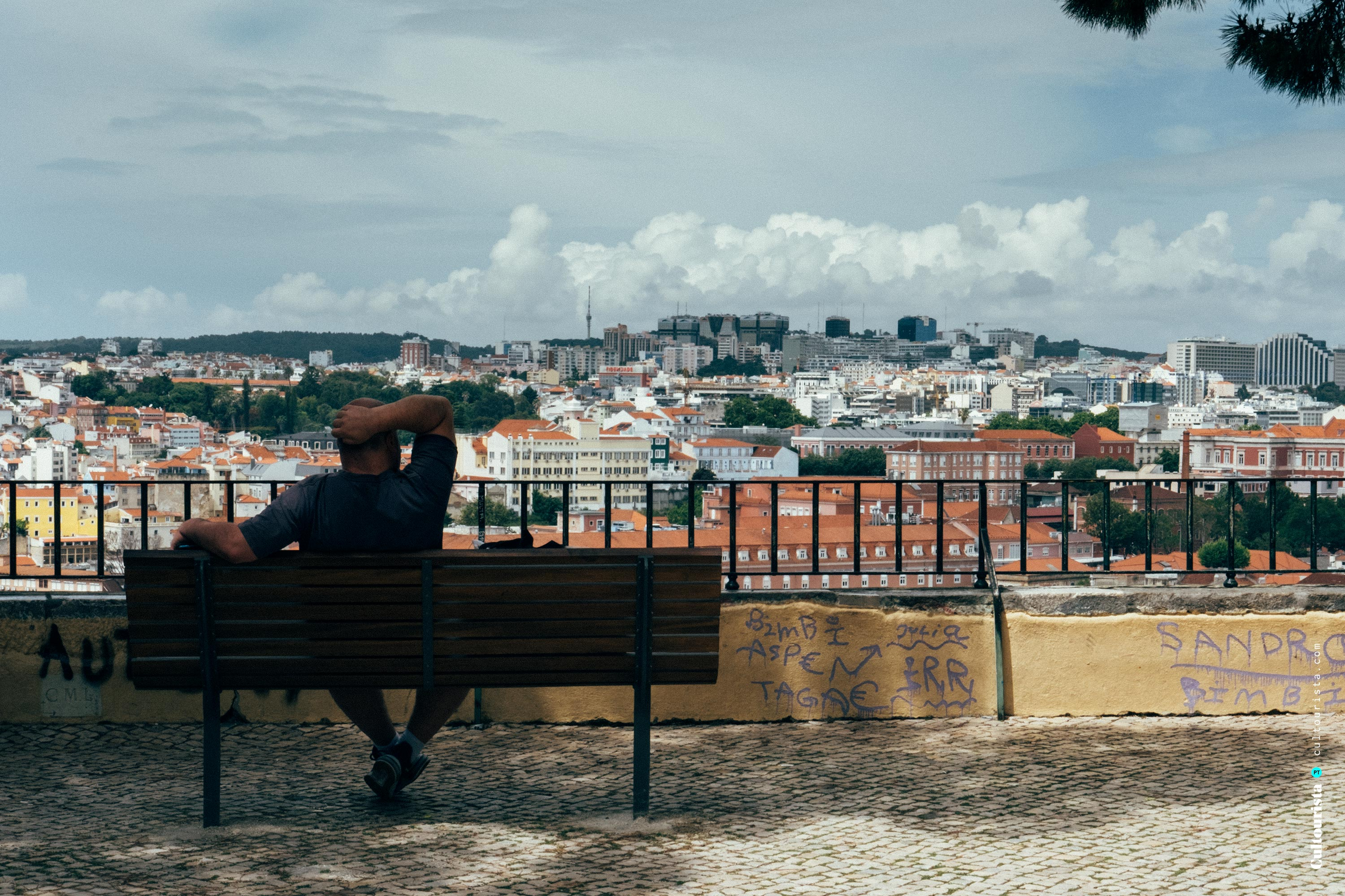 Viewpoint Graça and a person in Lisbon