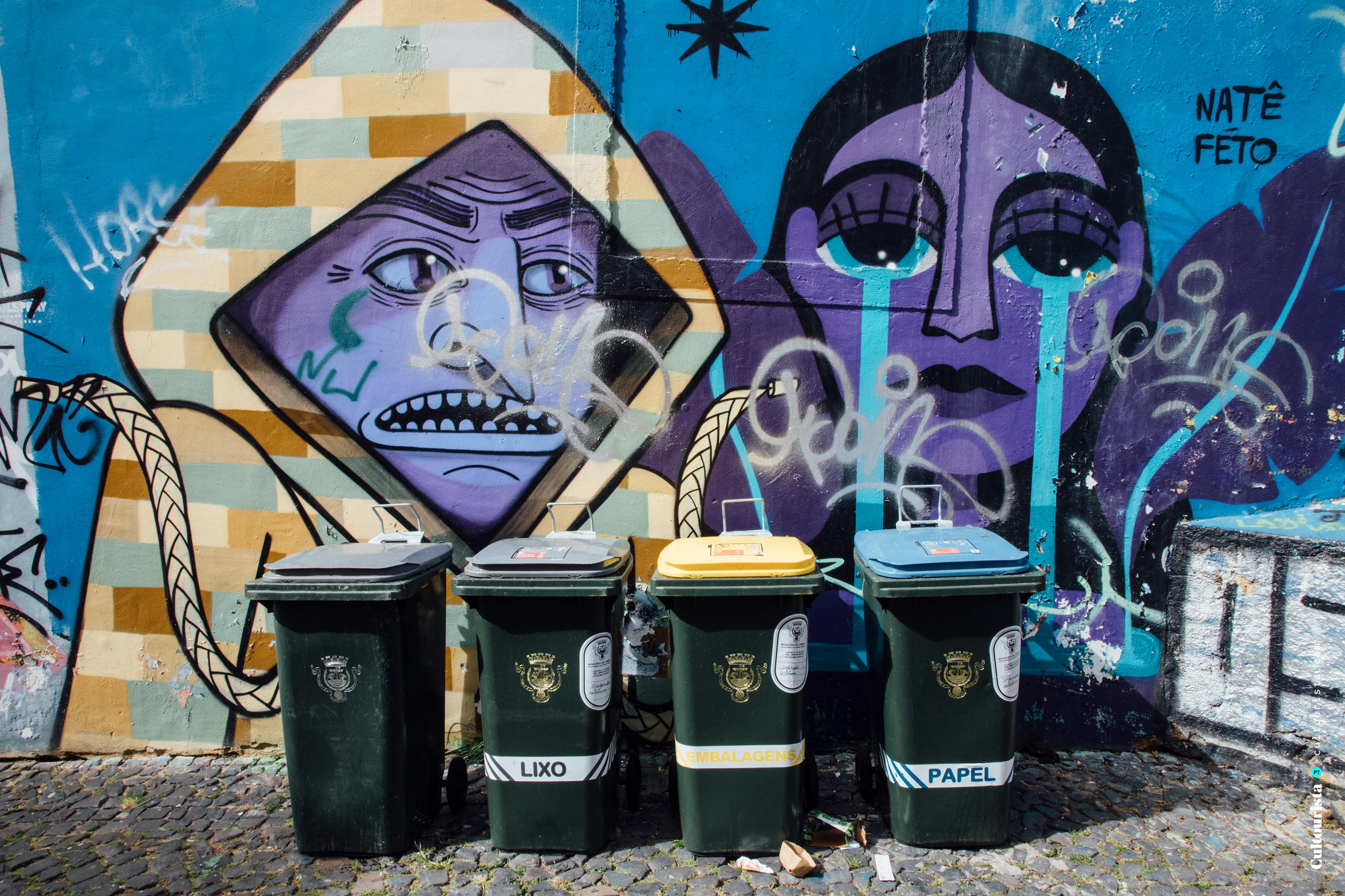 Bins and graffitis by the viewpoint Graça
