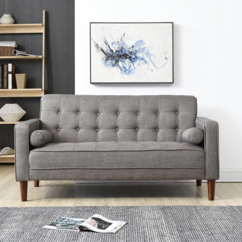 gray sofa with exposed legs
