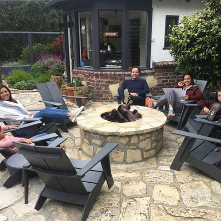 a group of people sitting around the fire