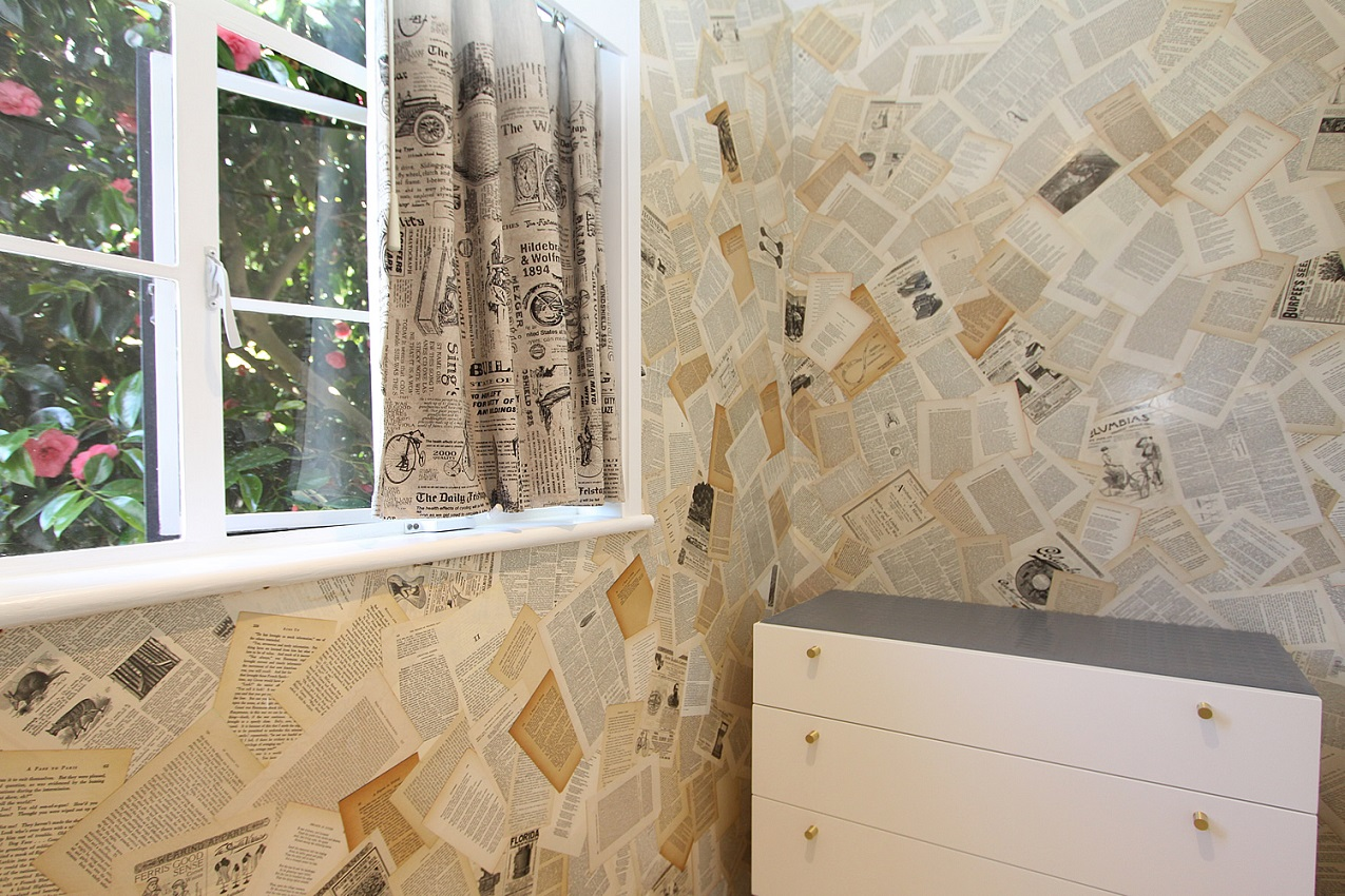 window, dresser, and room has wallpaper made of pages