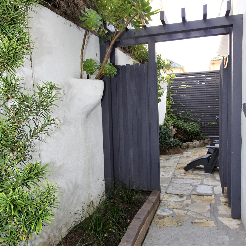 Grey gate with walking path