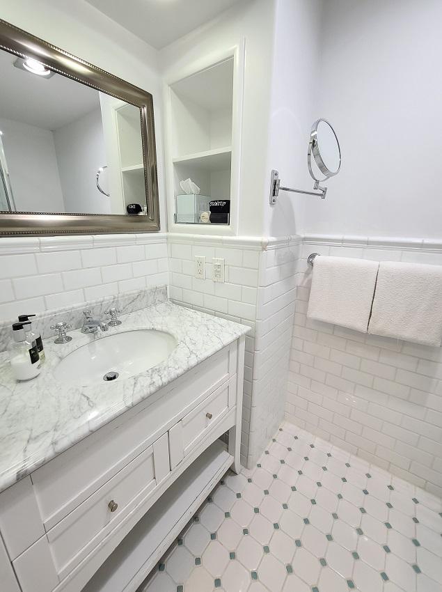 Bright bathroom with sink, mirror