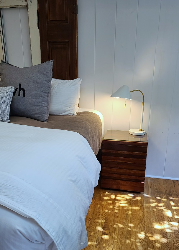 side table next to bed