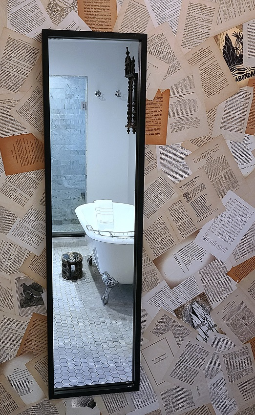 mirror with wallpaper made of pages
