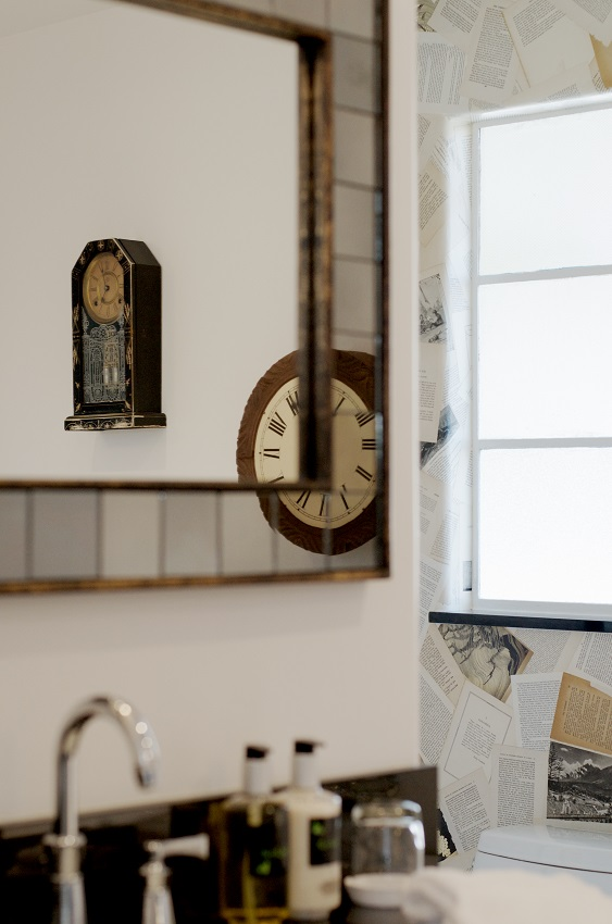 mirror, clocks, and sink