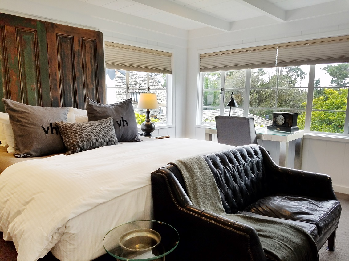 bed and leather couch