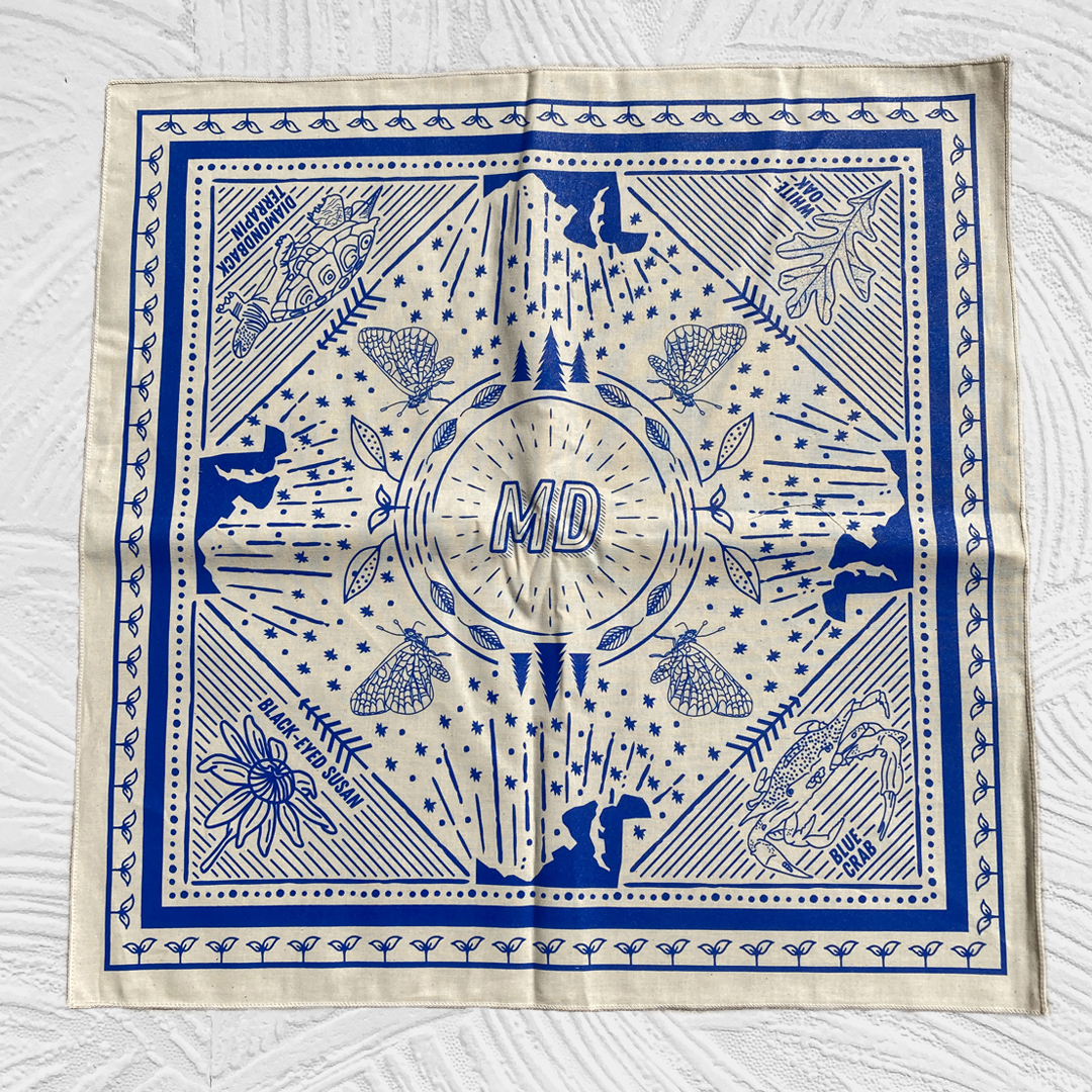Bandana with a blue ink on natural fabric showing symbols of Maryland including blue crab, white oak, black-eyed susan and a diamondback terrapin