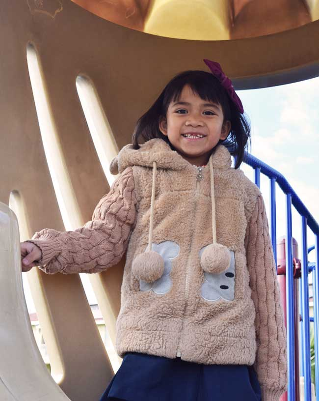 Photo of a young girl on a playground