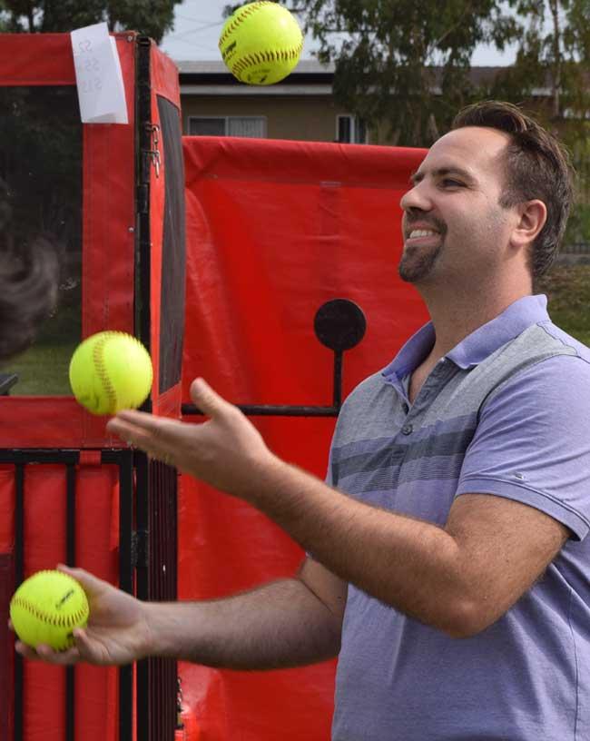 Photo of Principal Nic Lindquist juggling