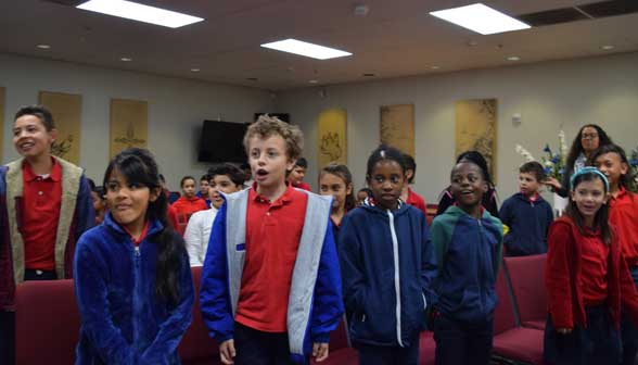 Elementary students participating in week of prayer