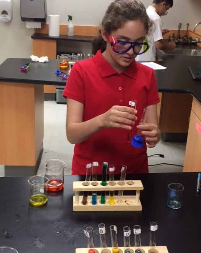 Student working in the Junior High science lab