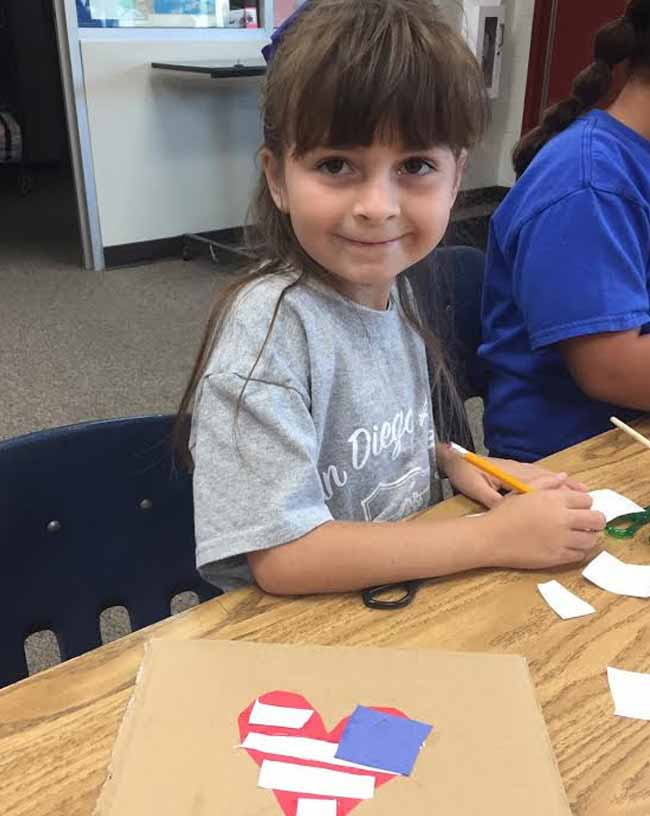 Elementary student having fun with an art project