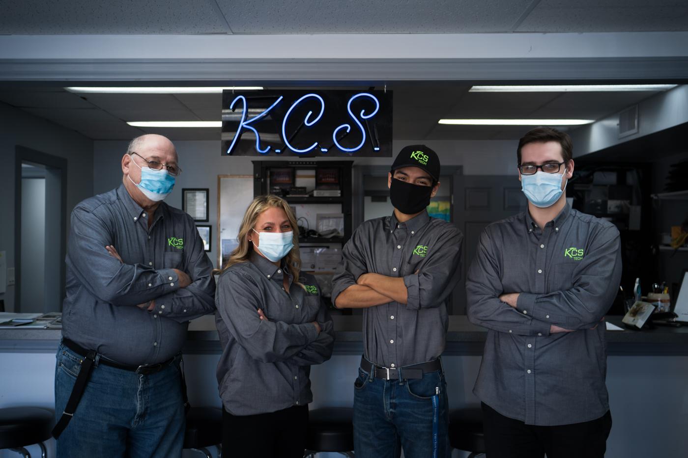 KCS storefront crew wearing masks