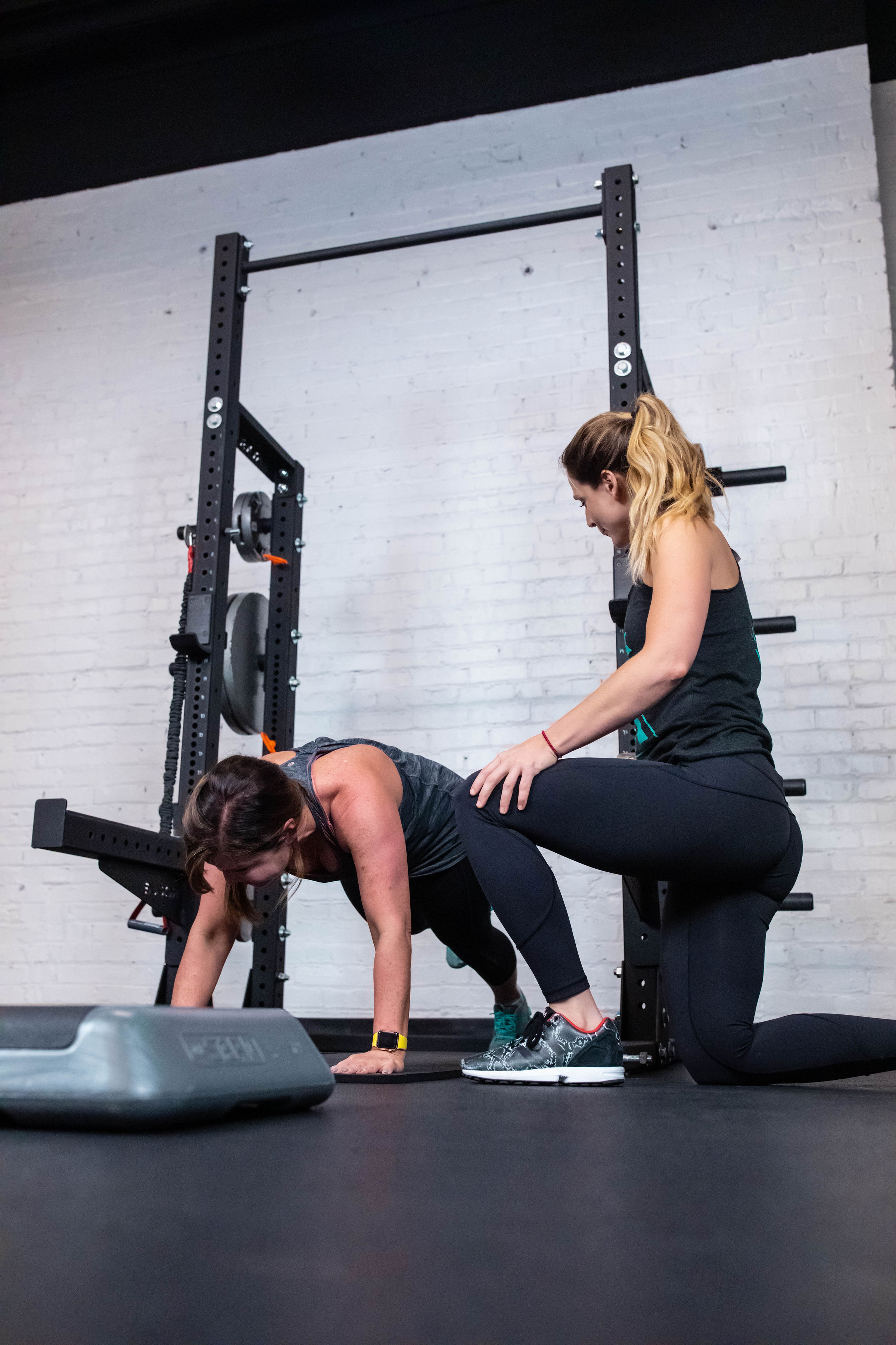 This is a picture of a client exercising with their personal trainer.