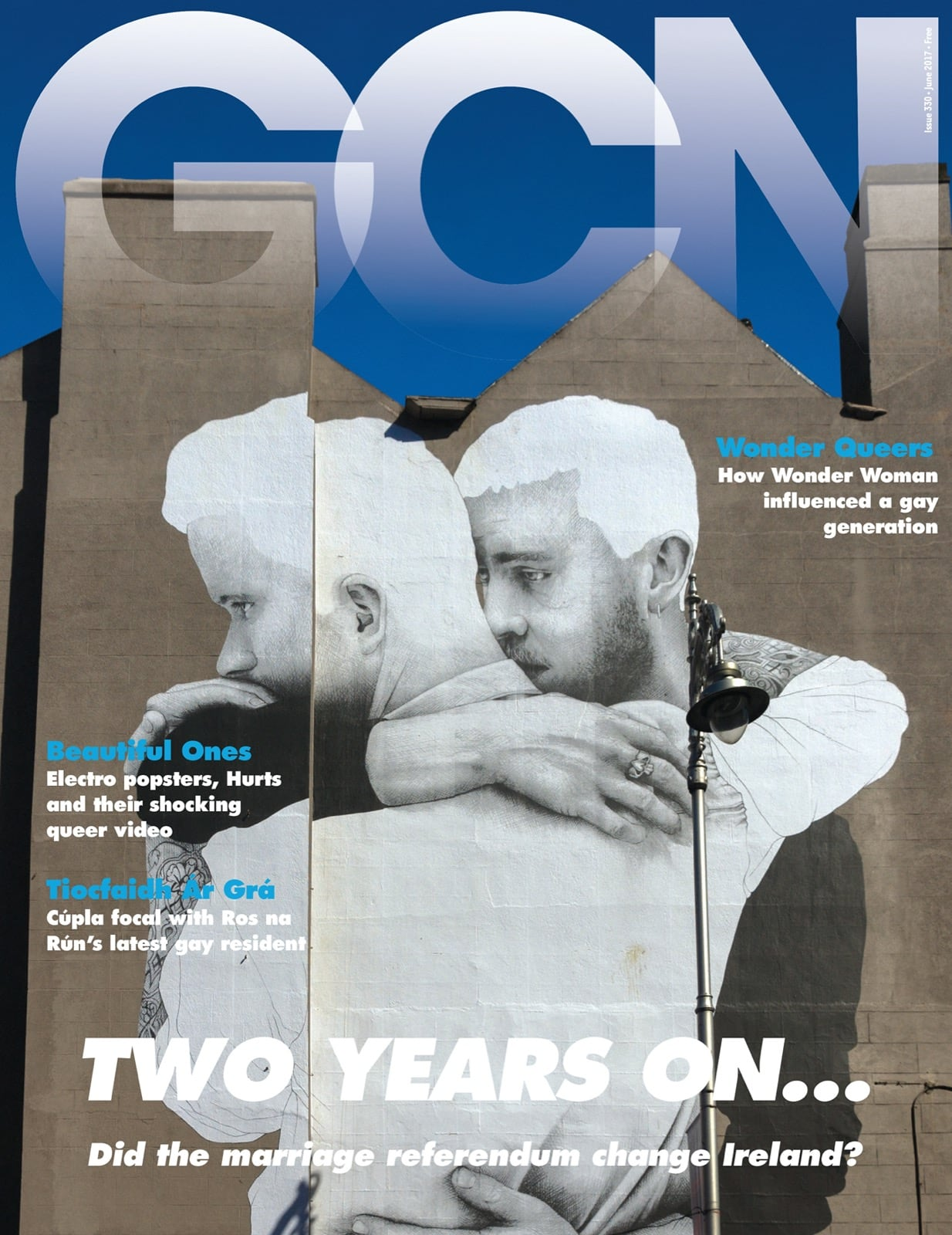 Some of GCN's covers from 2009 with a giant mural by Joe Caslin of two men embracing on the cover.