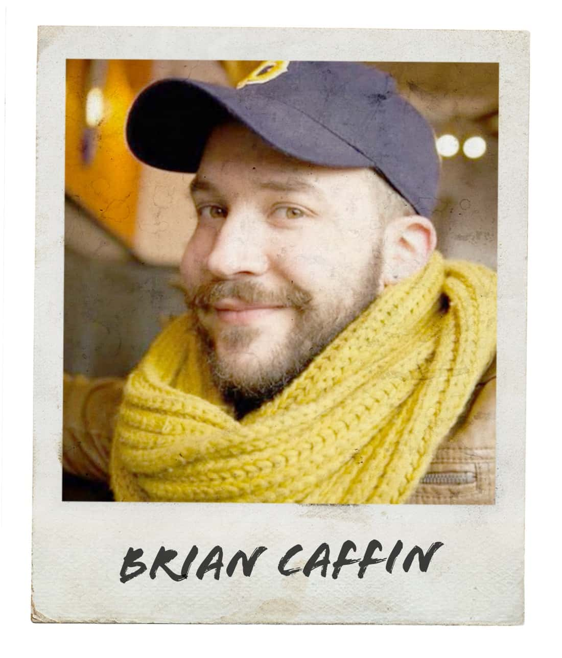 "Polaroid-style photo of bearded man wearing a blue cap and yellow scarf, taking a selfie for #mygcn campaign. Under the photo the caption reads ""Brian Caffin""."