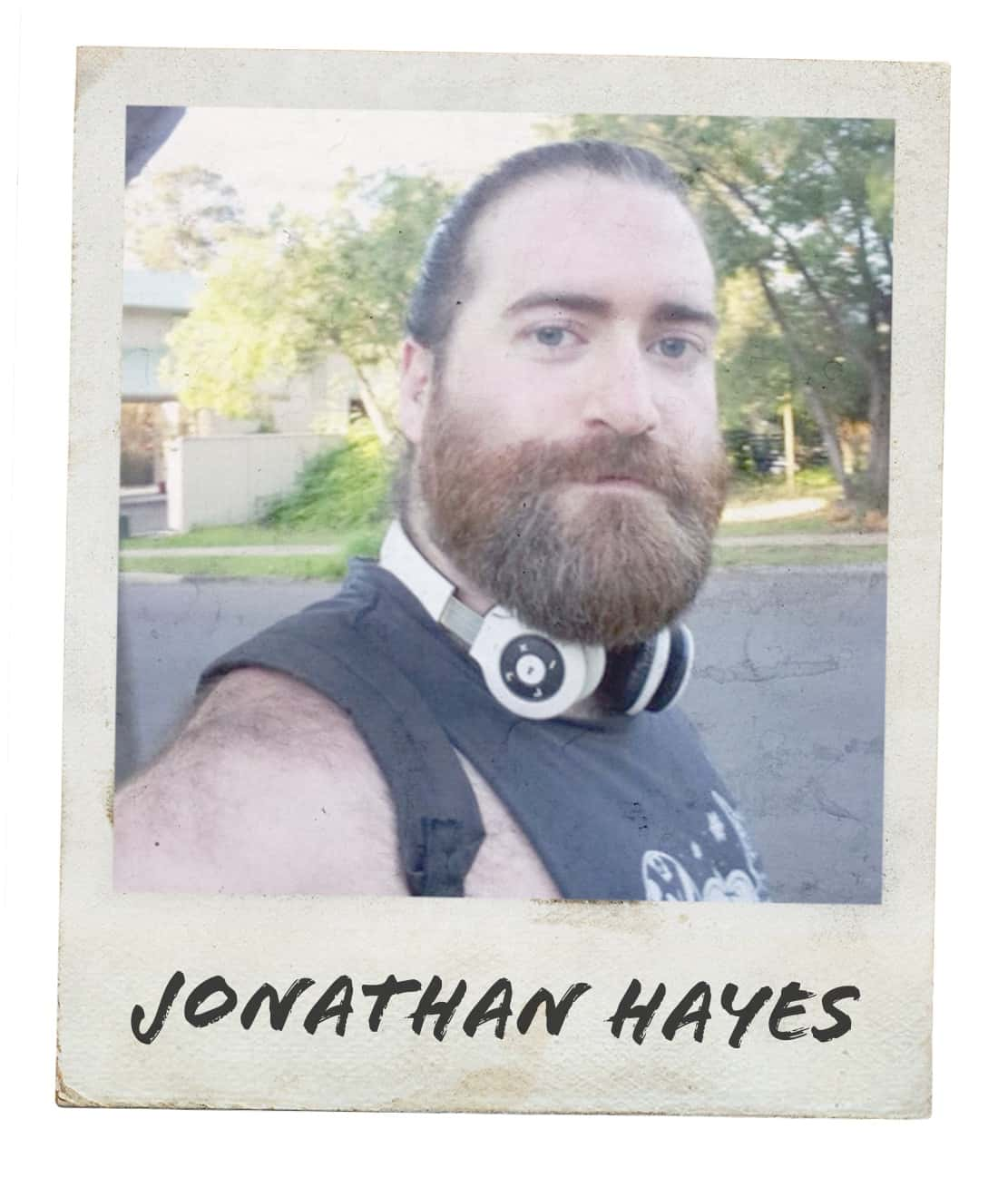 "Polaroid-style photo of bearded man with headphones taking a selfie for #mygcn campaign. Under the photo the caption reads ""Jonathan Hayes""."
