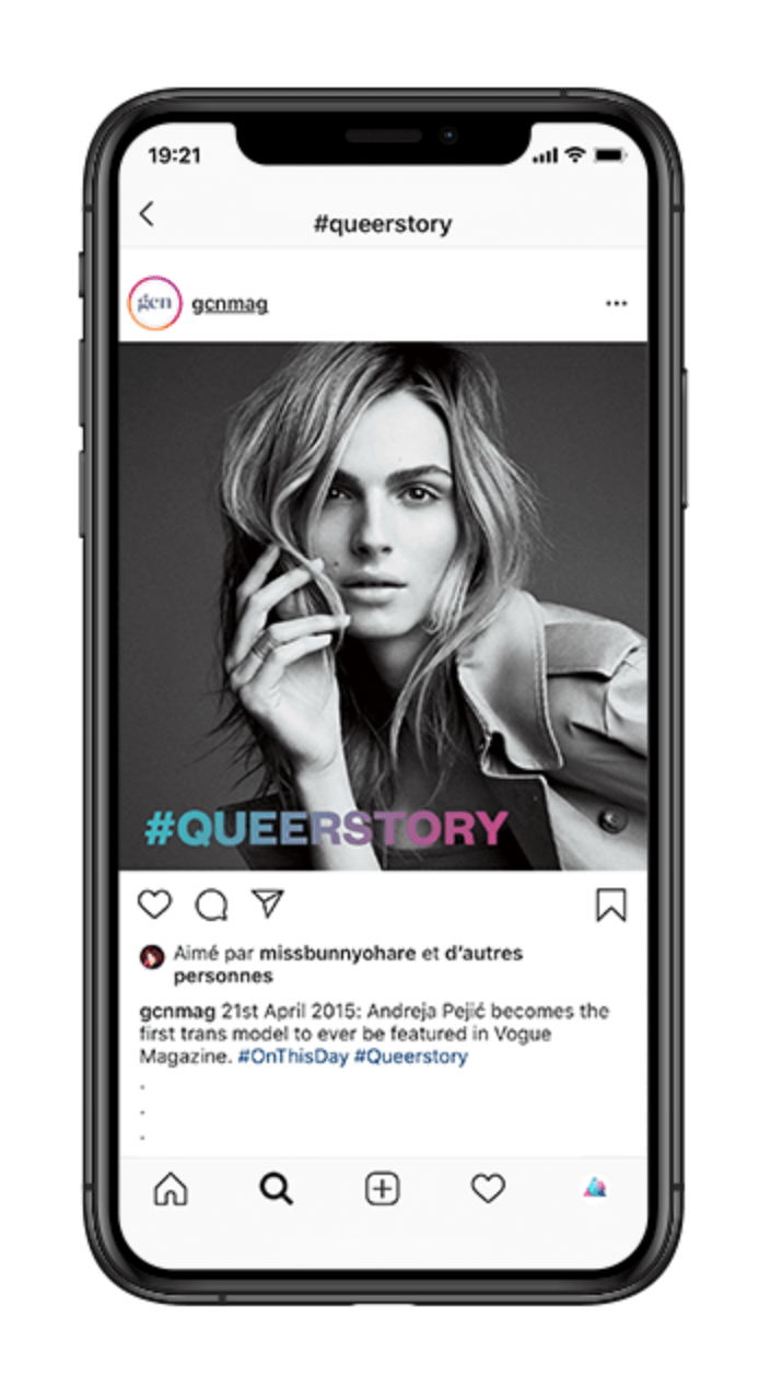 iPhone screen displaying a post from GCN's Instagram account. The post is a black and white photo of trans model Andreja Pejic. The #queerstory logo is running across the photo.