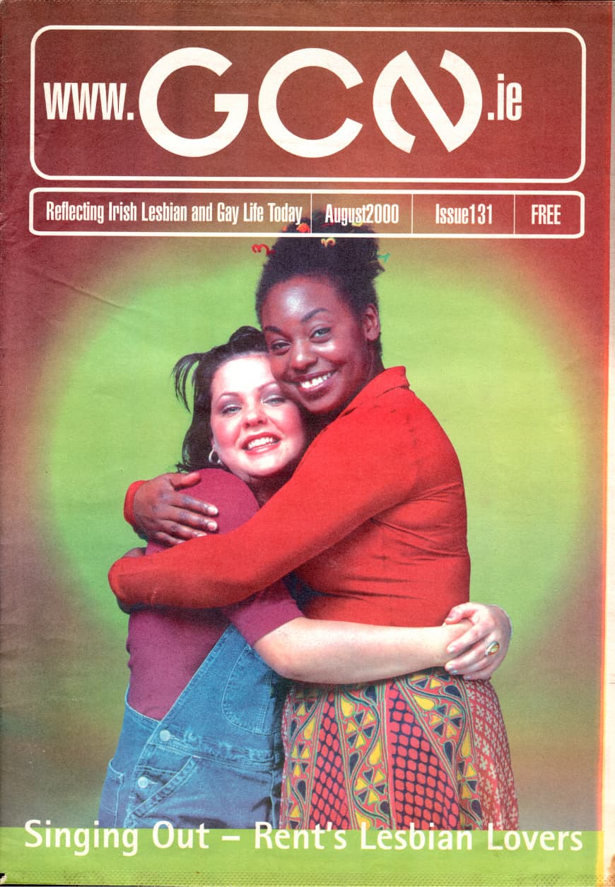 """Taking a look at the production process of GCN: Cover of GCN issue 131 fro August 2000 featuring two women hugging. The headline reads """"Singing Out - Rent's Lesbian Lovers""""."""