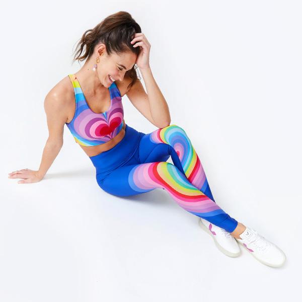 Woman wearing rainbow Terez leggings and sports bra