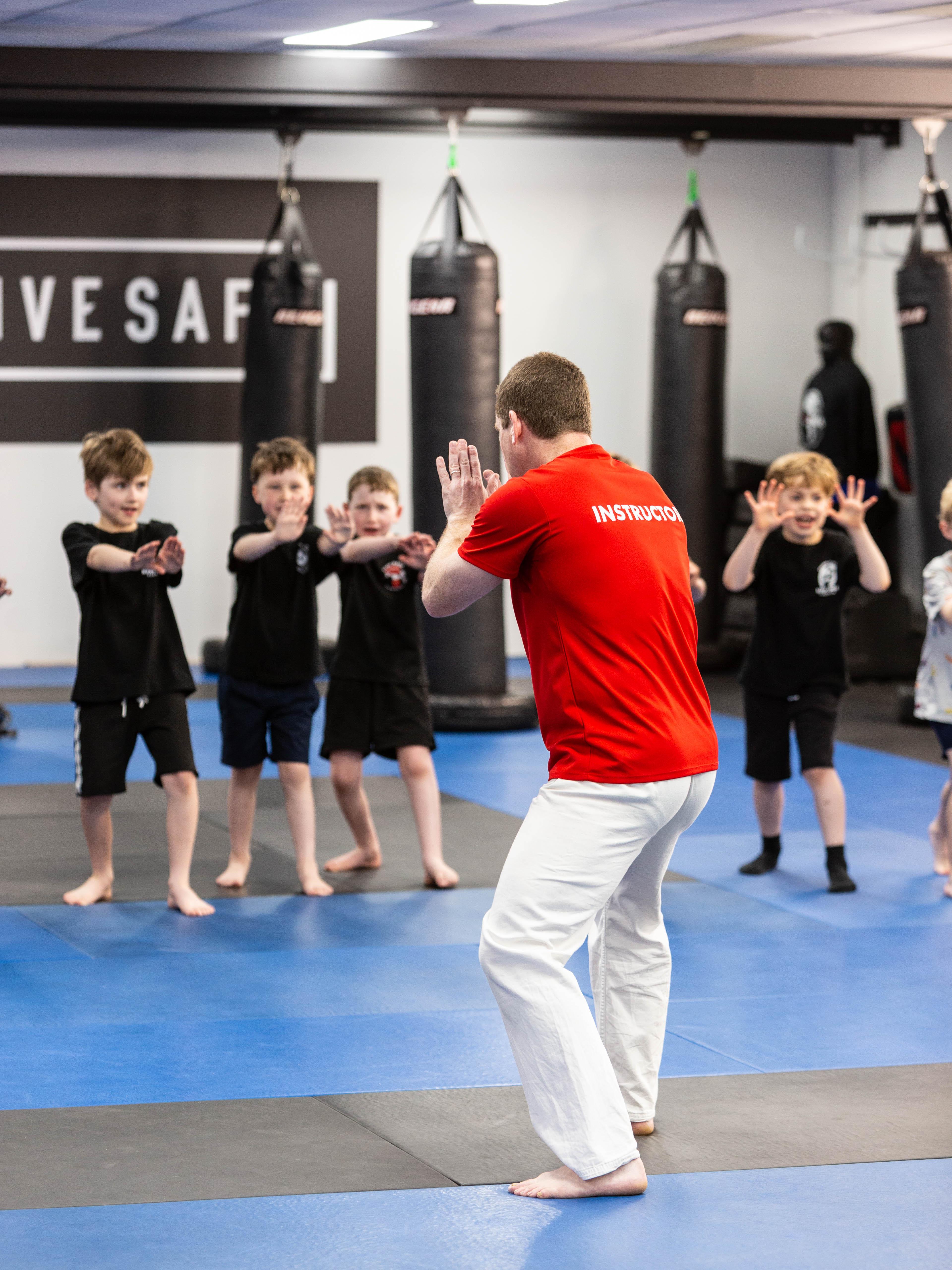Krav maga instructor leading class of children