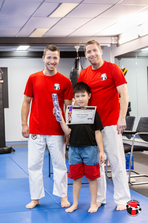 Krav maga student standing in front of instructors