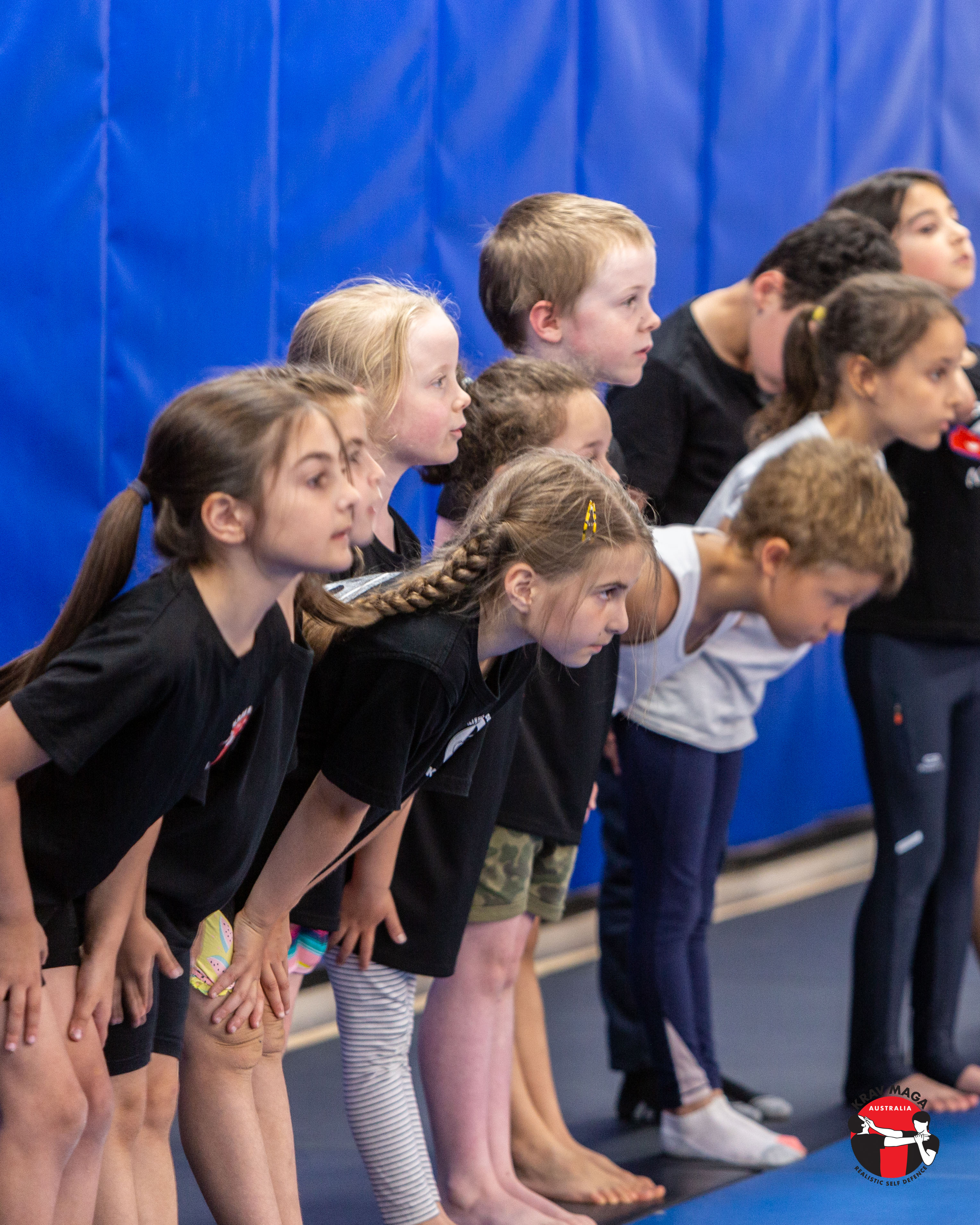 Small children bowing to instructors after Krav Maga class