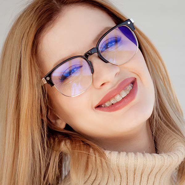 Smiling woman with clear braces
