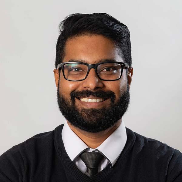 Dr Arun smiling
