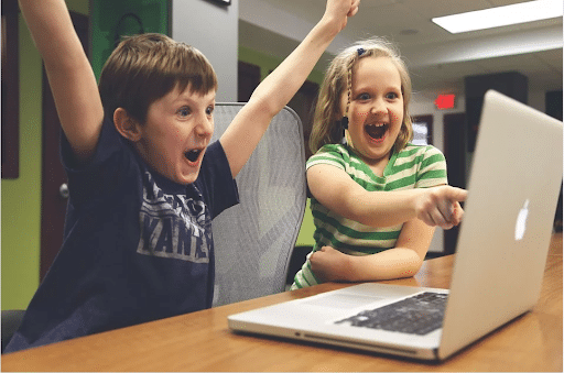happy children in front of a laptop