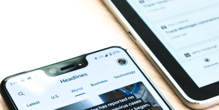 news headlines on cellphone screen