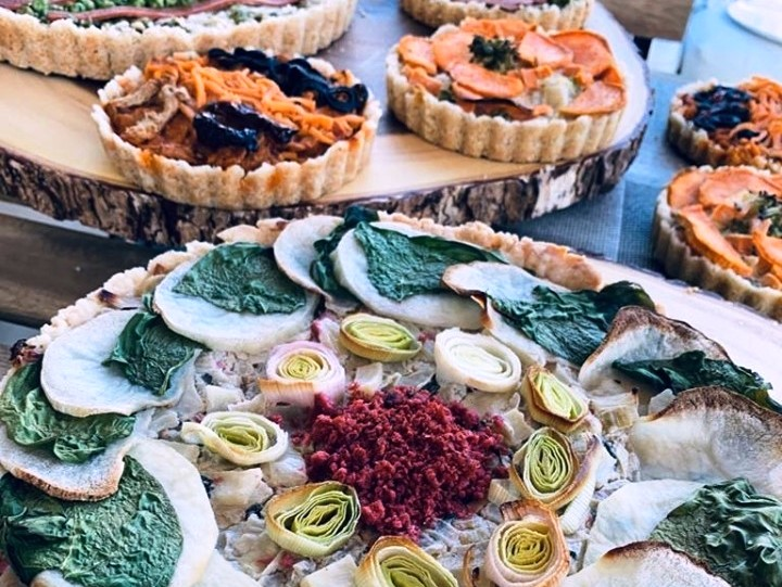 A colourful array of breathe kitchen vegan quiches and pies made in Vancouver, BC, by Daphna Kedem.