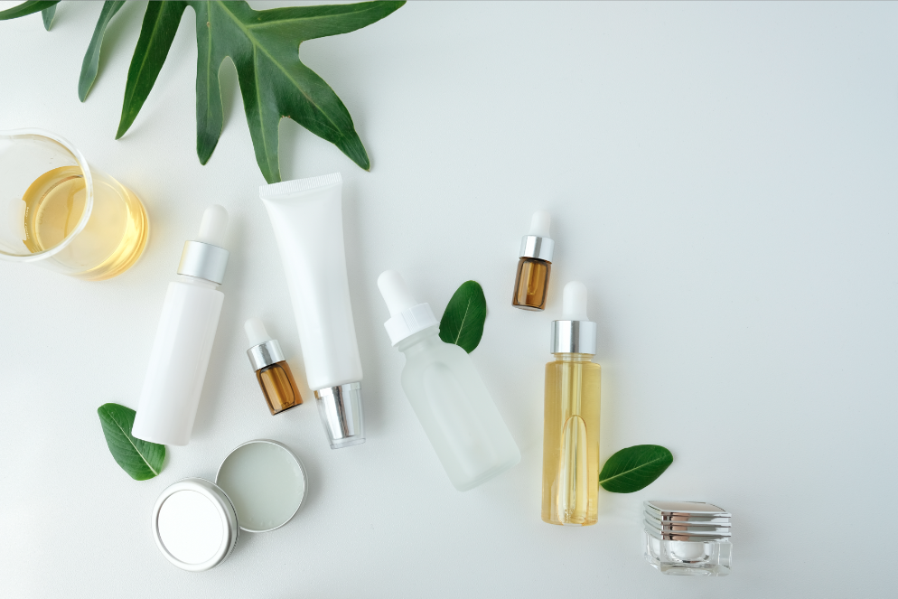 Generic photo of massage oils, creams and a leaf from a plant