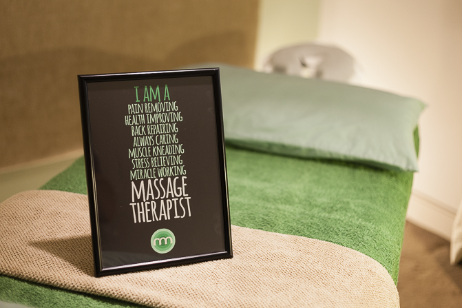 Massage table with green and coffee coloured towels in South Dublin
