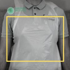 Daniel Raburski wearing a disposable apron