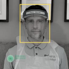 Daniel Raburski wearing a face shield