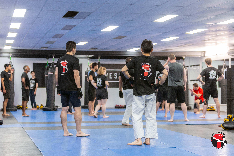 Krav maga instructor shadowboxing near mirror