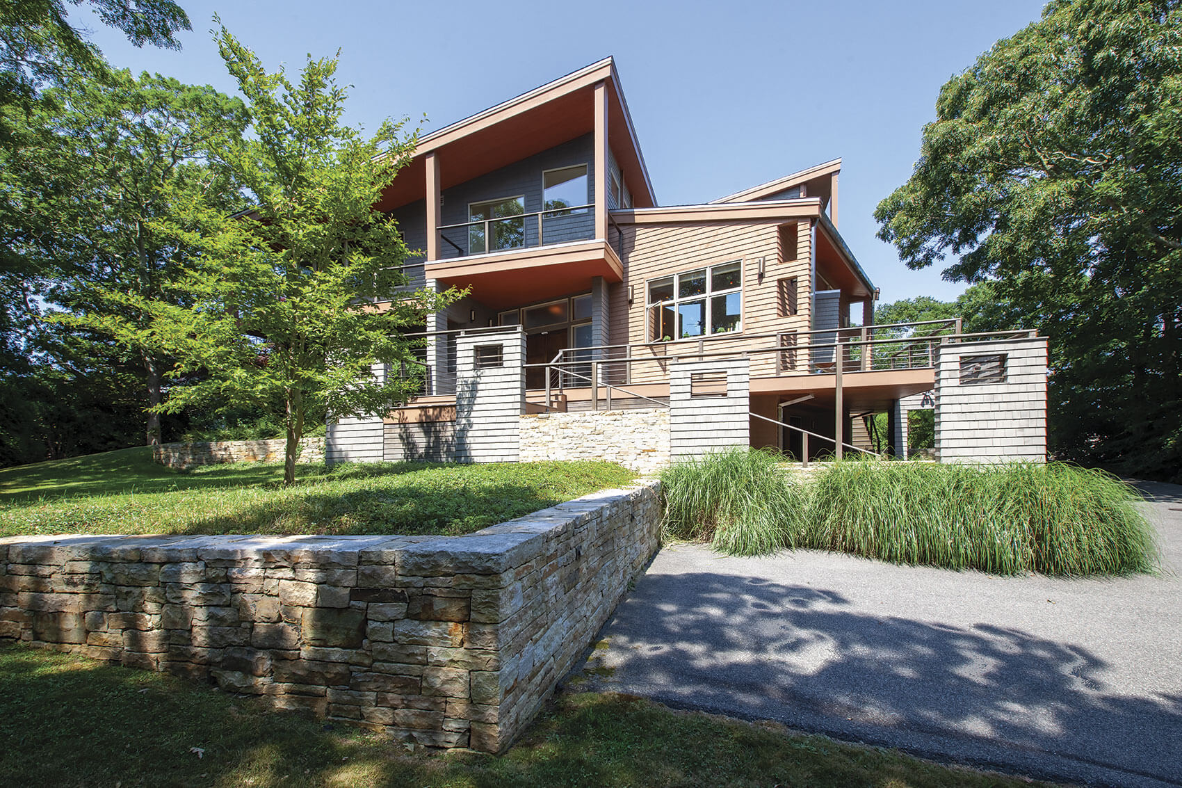 An exceptional five bedroom, 4,530 square-foot home sitting atop the highest point at the Sippewissett Highlands.