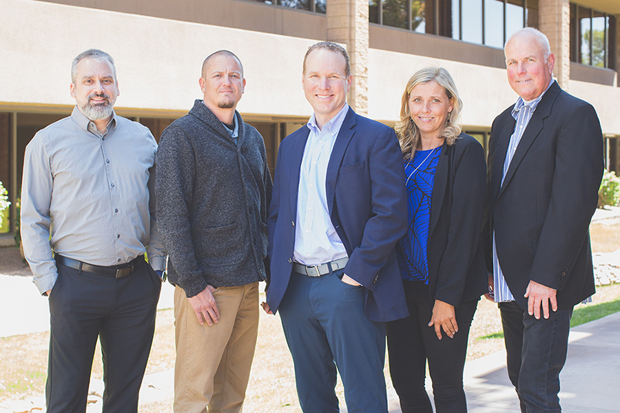 The ShareTek team stands outside smiling; from right to left: Ryan Eibling, Zac Henry, Steve Moak Jr., Allyson Morgan, and Jamie Kling.