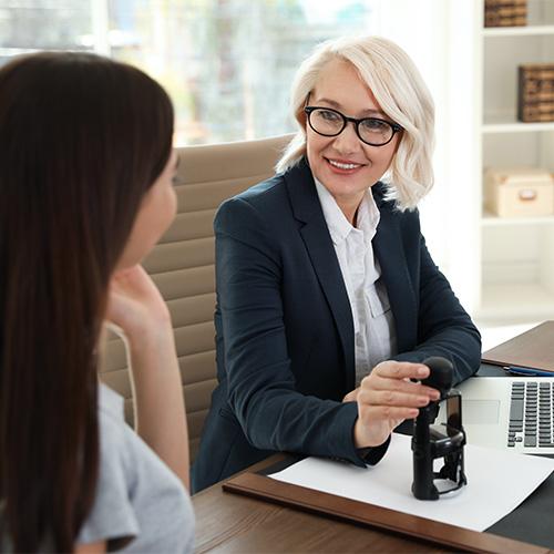 An older female employer talks to her employee.